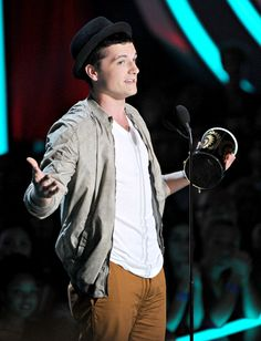 Josh Hutcherson photographed on stage while accepting the Best Male Performance award for his role in 'The Hunger Games' at the 2012 MTV Movie Awards.