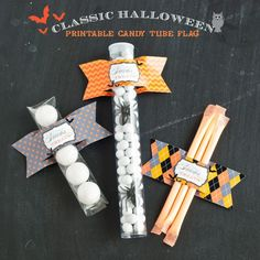 Halloween flag labels: cut two horizontal slits and slide object inside.  {Anders Ruff}