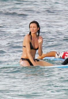 Cameron Diaz  Cameron is the ultimate guy's gal -- she famously won a burping contest on Nickelodeon, and she's incredibly athletic (see surfboard). So that explains the toned figure.