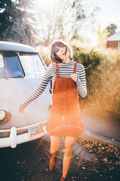 Tan suede pinafore dress paired with a black and white striped long sleeve top! Very retro and classic French!