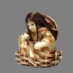 Katabori Haruko , she was carved from a walrus tusk her hair and make-up wered one in rose-urushi lacquer.The pattern on her kimono was done with a burnig needle and walnut ink, three petals were carved from pink coral. By Natasha Popova 2008