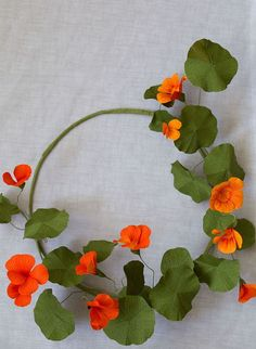 Nasturtium flower wreath How to make paper flowers with Jennifer Tran of papetal Paper flowers make gorgeous handmade gift toppers - or they can be gifts in themselves. Learn how to make a modern nasturtium flower wreath. Paper Flower Wreaths, Paper Flowers Wedding, Tissue Paper Flowers, Paper Flower Wall, Flower Crafts, Paper Garlands, Paper Decorations, Flower Making Crafts, Handmade Flowers