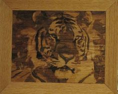 wood pieces cut and assembled into the images of a tiger.