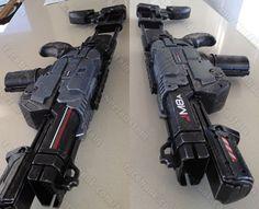 Mass Effect blaster carbine mod of a Nerf Praxis. Cool gun but a pain to prep. Made a light up ammo cart also.
