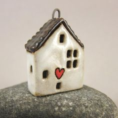 Love Lives Here...Stoneware Pendant / Ornament by elukka on Etsy
