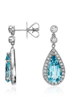 These exquisite aquamarine and diamond drop earrings feature more than 4 carats of pear-shaped aquamarines framed by a delicate halo of brilliant round diamonds