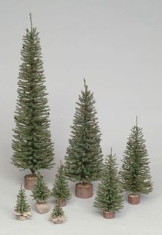"Description 1 Tree - 32"" Carmel Pine Tree With 320 PVC Tips, Wood Base. Image for Reference Only. Specs Color: Green Light Style: Unlit Tips: 320 PVC Tips Primary Material: PVC Size: 32 in. Height: 32"
