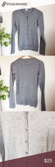 Gray Long Sleeved Button Down Cardigan Tex by Max Azria. Grey button down sweater/cardigan with long sleeves. Excellent condition! Super comfy and stretchy. Size medium. 60% cotton 40% viscose. BCBGMaxAzria Tops Sweatshirts & Hoodies