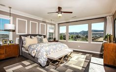 The generous master suite showcases two spacious walk-in closets plus a private bath with dual sinks and separate tub and shower. - Residence 4 at Newbridge at Heritage Lake in Menifee, CA