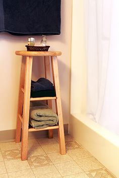 Re-purpose a bar stool into shelves. Paint the stool and crochet a cute seat cover.