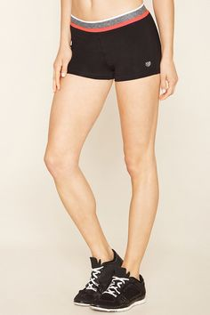 A pair of stretch-knit athletic shorts featuring a heathered waist with fluorescent trim.