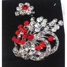 Red brooch and flower pin