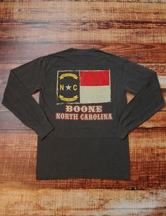 Show your Boone, North Carolina pride in this pepper Comfort Colors long sleeve t-shirt. Barefoot Boone Grunge Flag - PEPPER