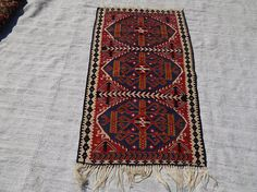Check out this item in my Etsy shop https://www.etsy.com/listing/521806119/small-kilim-rughandwoven-rughome