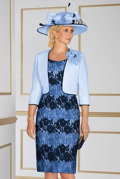 70863 (Condici) Crepe and lace dress with matching jacket in Lemon Fizz & Heavenly Blue. The dress is a shift style with a rounded neckline and 3/4 length sleeves. The skirt is knee length. The Crepe jacket has contrasting Navy piping and a two tone corsage.