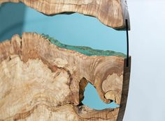 """Greg Klassen is an artist who creates beautiful wooden tables with glass rivers and lakes embedded into their surfaces. """"I try to marry the natural beauty of the wood with the skilled craftsmanship of the maker,"""" explains Klassen. Glass Wood Table, Wood Table Design, Glass Tables, Wood Tables, Table Designs, Wooden Furniture, Furniture Design, Glass Furniture, Furniture Outlet"""