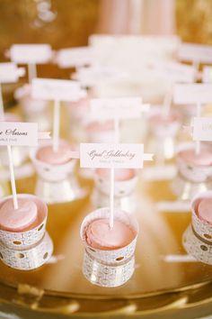 macaron escort cards, photo by Kati Rosado Photography http://ruffledblog.com/southern-florida-wedding-inspiration #weddingideas #seatingchart