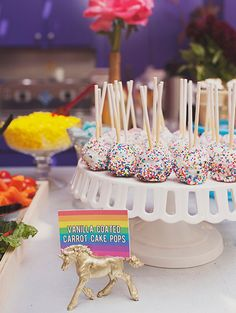 Rainbow sprinkle cake pops and gold unicorns