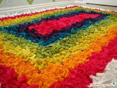 Latch hook rug made with old tshirts! I've always wanted to make one of these!