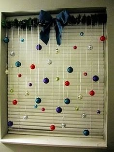 Tension rod with ribbon and Christmas bulbs. Snowflakes would be cute too.