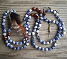 15% off! Like little crashing waves, this 108 beaded mala is hand knotted with gorgeous matte sodalite, wood, and finished with a hand made (cruelty free) feather pendant. Mala necklace measures 16.5 from top to bottom. Yoga friendly. Namaste ♡