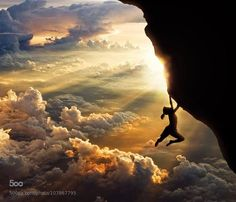 Mountain climbing girl hanging from cliff with sunset and golden clouds in the background. Amazing breathtaking photography. Please also visit www.JustForYouPropheticArt.com for colorful inspirational Prophetic Art and stories. Thank you so much! Blessings!