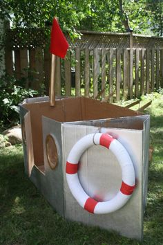 Cardboard Boat for photo op with styrafoam life preserver and hat out front