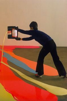 Lynda Benglis creating a floor piece, using 50 gallons of latex and 80 pounds of pigment. Photo by Henry Groskinsky.