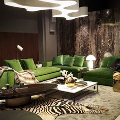 High rollers suite in @minotti_spa leonard sofa in evergreen, monochromatic interior and gold accents. Very strong concept by @jokeroos realized in #moievipsummerparty2015 at #minottijakarta. Ameba by @vibia