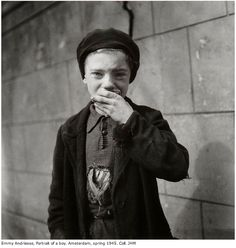 Emmy Andriesse Photographs of Jewish Amsterdam, War and Liberation.  In jewish quarter- boy eating