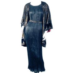 Fortuny black silk Delphos gown and a black silk velvet jacket, stenciled in silver and gold