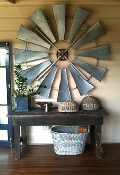 Gpa Pete has a big windmill in his shed... maybe on the big tall wall over the staircase? Maybe make it into a big clock???