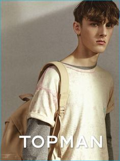 Topman revisits 90s style, layering a t-shirt over a long sleeve tee.