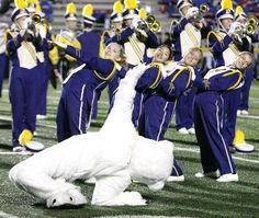 The Jackson Polar Bear busts a move with members of the Jackson band during the halftime show in week four of the high school football season.
