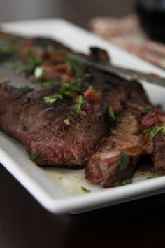 Flank Steak w/Shallot, Butter & Balsamic Sauce    2 pound flank steak   salt/pepper   1 tablespoon extra virgin olive oil   2 tablespoons unsalted butter   1 shallot - minced   2 tablespoons balsamic vinegar   1 tablespoon fresh flat leaf Italian parsley - roughly chopped