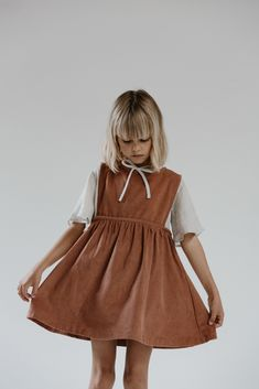 Daughter produces natural, ethical childrenswear from unique cotton and linen fabrics sourced from around the globe. Cute Little Girls Outfits, Little Girl Fashion, Girly Outfits, Boy Outfits, Kids Fashion, Designer Childrenswear, Brown Outfit, Kids Wardrobe, Trendy Kids