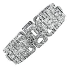 Lacloche Art Deco Diamond Bracelet. Platinum Art Deco Bracelet by Lacloche Freres consisting of Old European, marquise, emerald cut and single cut diamonds having an approximate total weigh of 20.00 carats. The bracelet measures 7.25 inches in length.