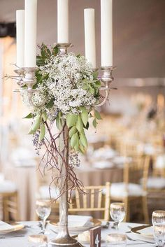 so simple yet so elegant! love the combo of baby's breath, greens and candles in this tall wedding centerpiece! ~ we ❤ this! moncheribridals.com