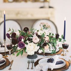 Gorgeous navy taper #candles and deep purple flowers in this opulent #WeddingSetting
