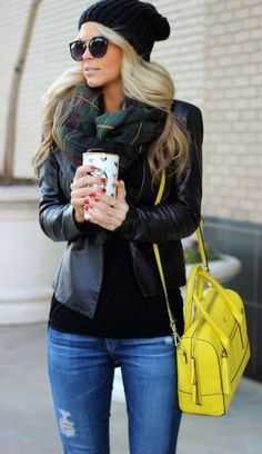 Streetstyle. Yellow bag with a black leather jacket, the scarf is plaid, also she is wearing a woven hat.