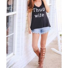 Black Thug Wife Graphic Tank Top Size Medium Black white print Thug Wife graphic tank, 95% rayon 5% spandex, size Medium.  No Trades, Price Firm unless Bundled.  BUNDLE 3 OR MORE ITEMS FOR 15 % OFF. Boutique Tops Tank Tops