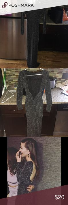 Evening dress This reflective silver dress is perfect for a fancy night out. The material is so stretchy and form fitting its guaranteed to show off your best features. The back is a deep plunge with a metal wire to hold the shape. Worn once. WINDSOR Dresses Long Sleeve