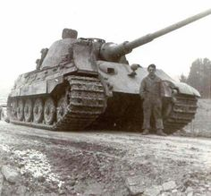 A King Tiger with a crew member that gives a good comparison detailing the size of this tank.