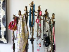 Using a candelabra to organize your necklaces and scarves!