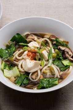 NYT Cooking: Topping the list of the most satisfying meals, a big steaming bowl of noodles in broth nurtures body and soul. Though many noodle soups rely on long-simmered meat stock, this vegetarian broth is quickly prepared and very flavorful. The recipe calls for thick chewy udon noodles, but use another type of noodle, if you wish.