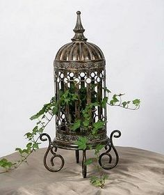 Bird cage....I have one with a huge candle in it but I now need one for an ivy and one for fairy lights. Is this bird cage overkill?...would add colorful ribbon on top