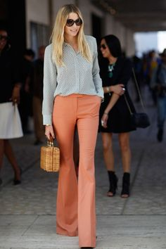 60s inspired flared pants are not only a great way to try out an exaggerated look, they also elongate your legs. Try one in color like the photo above and pair with a retro print blouse or opt for a simple white v-neck to give it a modern touch.