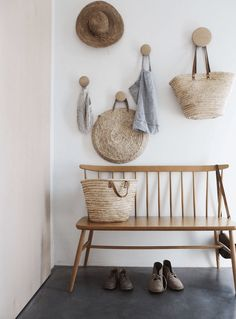 Modern rustic minimalist hallway with Ercol bench in hallway. We look at the best ways to create a beautiful hallway in your home.