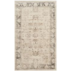 Add a classic touch to your favorite room with this vintage-style viscose rug. The neutral stone background with a distressed oriental design will match almost any decor, and the soft viscose fibers and short pile will feel comfortable under your feet.