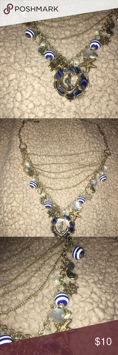 Nautical necklace Blue, white and gold necklace  Different shapes and sizes of charms Jewelry Necklaces
